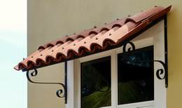 Clay tile window awning with wrought iron brackets