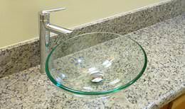 Granit bathroom countertop with glass vessel sink