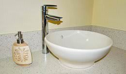 Corian bathroom countertop with modern vessel sink