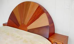 Custom-made tropical hardwood bed with half-moon headboard