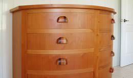 Custom-made half-moon chest of drawers made out of tropical hardwood