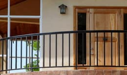 Iron terrace railing with entry door