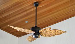Tropical hardwood ceiling with recessed light and leaf blade ceiling fan